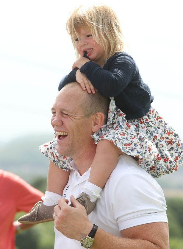 Mike Tindall plays with daughter Mia as she wows crowds with Zara