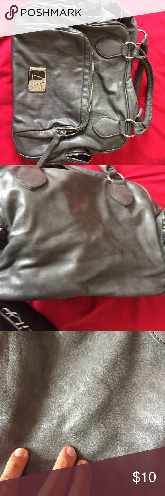 Armani exchange bag. Grey color Overall in ok condition. It has some parts a little torn, but still can be used.  It has the authenticity certificate A/X Armani Exchange Bags Totes