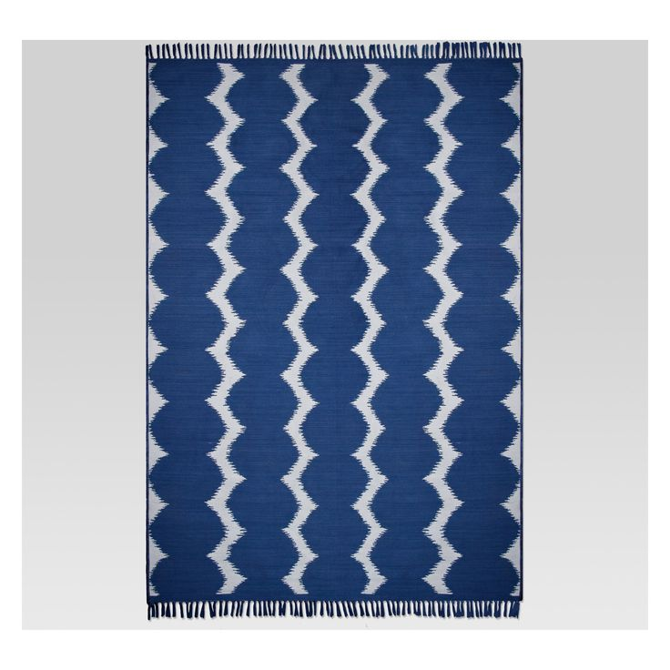 Elevate the overall look of your patio decor with the Ikat Dot Cool Outdoor Rug from Project 62™. With fringed edges and a stylish ikat dot pattern, this modern outdoor area rug will work great as the focal point for your open-air dining space or as a simple accent piece for an outdoor conversation area. <br><br>1962 was a big year. Modernist design hit its peak and moved into homes across the country. And in Minnesota, Target was born — with the revolutionary i...