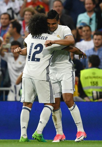 Casemiro of Real Madrid (R) celebrates as he scores their first goal with Marcelo during the La Liga match between Real Madrid CF and FC Barcelona at Estadio Bernabeu on April 23, 2017 in Madrid, Spain.