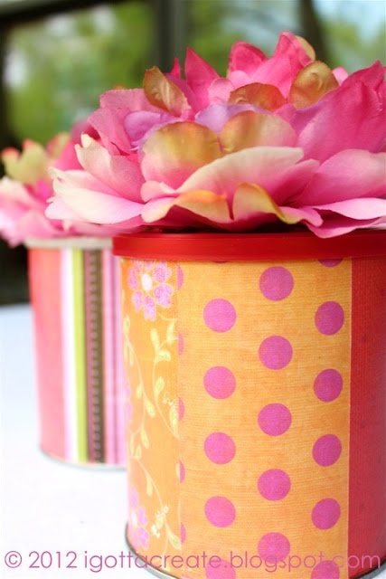 Cute paper covered containers for centerpieces. Cheap and you can get any colour scheme you like.