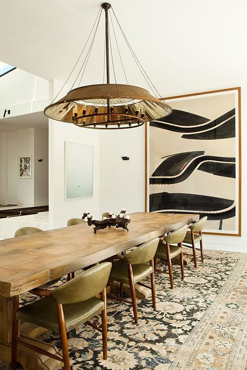 What a wonderful classic rug! Love how it balances the simplicity of the table, chairs, white walls, and art work.