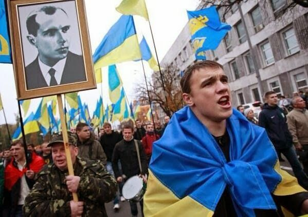 Svoboda members during Maidan protests with a portrait of the nazi-colaborationist Stepan Bandera.