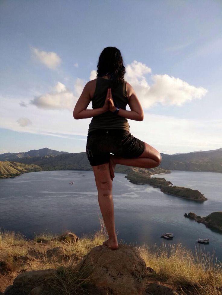 Sun Salutation on the peak of Gili Lawa Darat Hill, Labuan Bajo
