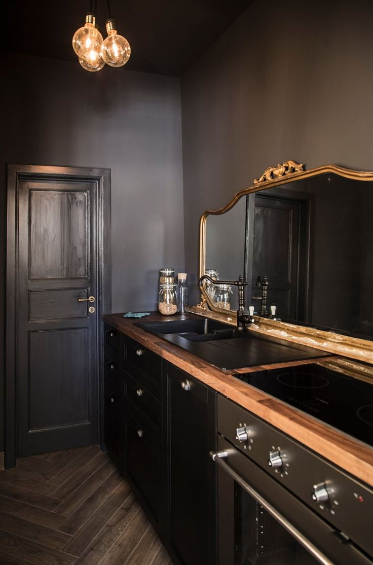 Modern black kitchen, antique mirror/ Francesca Timperanza