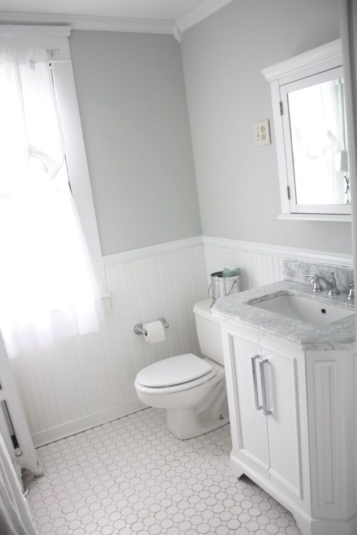 """White Carrara Bath Vanity with Top. Lowes  American Olean 12"""" x 12"""" Sausalito White White Ceramic Floor Tile Delta Faucets Beadboard, Crown Molding, and Corner Blocks Lowes Wall Color Sherwin Williams Evergreen """"Silverpoint"""" Trim Color Sherwin Williams Cabinet and Trim Paint, Semi-Gloss """"Extra White"""""""