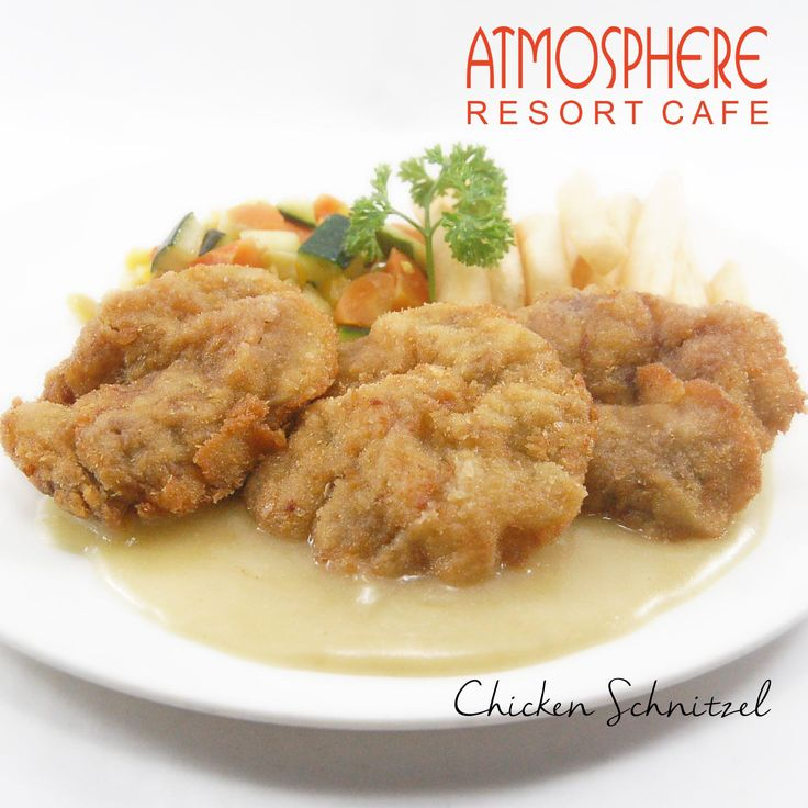Breaded beef tenderloin served with french fries & regular vegetables, in a tasty white sauce
