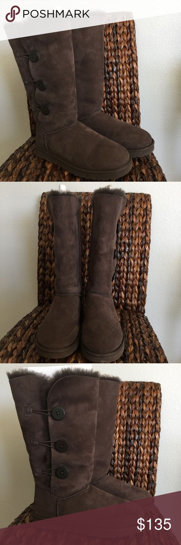 UGG Triplet Chocolate Bailey Button Boots Brand New and without the original box, but comes with an UGG box. 100% Authentic. Color: Chocolate Size: 10 UGG Bailey Button Triplet is a fresh take on Uggs Classic Tall model. Featuring wooden buttons with UGG logo with elastic band closures. These boots can be worn tall or cuffed to expose cozy shearling interior. Suede upper, fully sheepskin lined, cushy foam insole covered with UGGpure, and patented EVA outsole. UGG Shoes Winter & Rain Boots