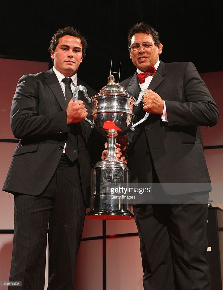 Former All Black Wayne Shelford (R) presents Zac Guildford (L) with the Tom French Memorial Trophy for Maori Player of the Year during the 2009 Steinlager New Zealand Rugby Awards at Sky City Convention Centre on December 17, 2009 in Auckland, New Zealand.