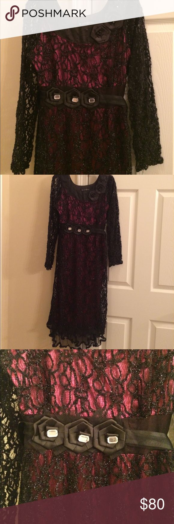 Juniors dress A very beautiful evening dress for junior girls or women in small size. It is used very gently and still in perfect condition. Black shiny net with magenta lining and double frill at the bottom give it perfect party look. Dresses