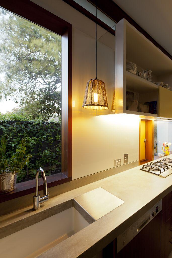 (c) Brett Boardman  Architecture, Window, Kitchen, Concrete Bench, Timber, Light, Pendant  http://www.samcrawfordarchitects.com.au/campbell-house-2/#