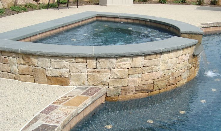Custom pool and spa with blue stone coping and natural for Custom pool and spa