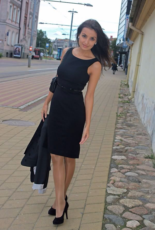 Very Pretty Woman In A Nice Black Dress Pantyhose And