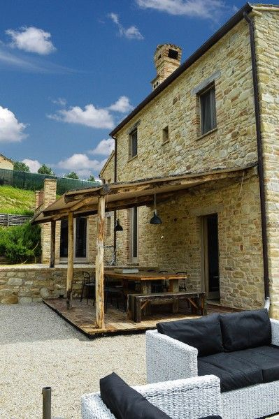 Al fresco living room for this ancient property immersed in the #countryside of #LeMarche - #Italy
