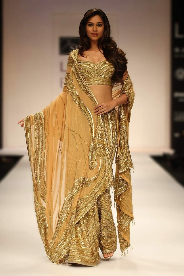 Golden swirled sari by Satya Paul.
