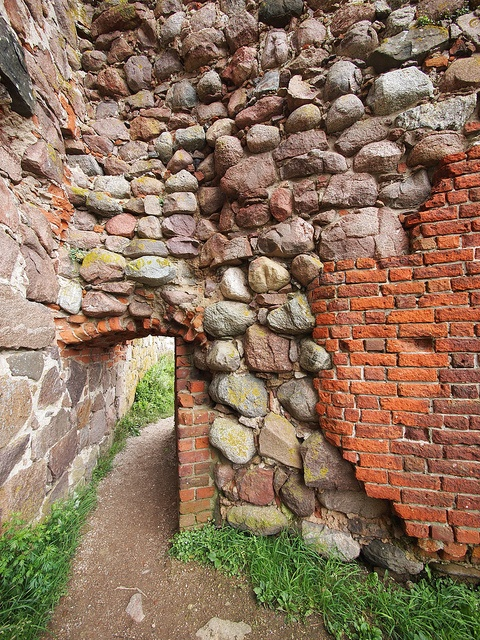 arched portal at Bornholm Castle, Baltic (what a fabulous wall!)
