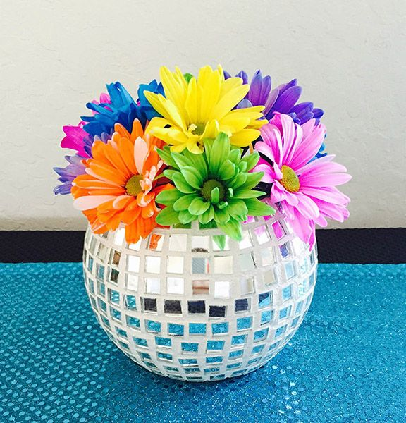 You can create this DIY disco ball vase for your Studio 54 Disco party or even home decor. Learn how to create this vase with 4 steps. http://sparklerparties.com/blog/diy-disco-ball-vase/