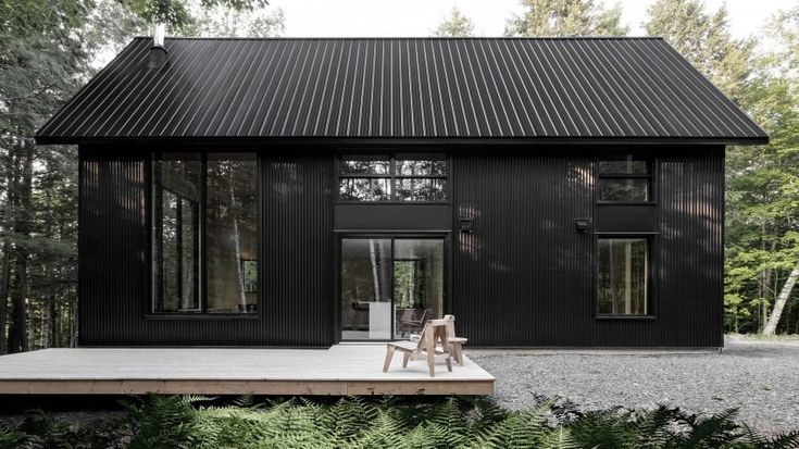 https://www.dezeen.com/2017/11/22/chalet-grand-pic-black-metal-cabin-forest-quebec-canada-appareil-architecture/