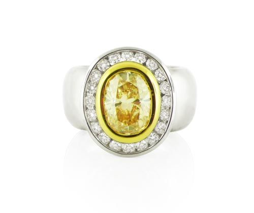 A Modern 18ct Yellow and White Gold Fancy Yellow Diamond Ring