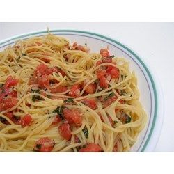 This very quick pasta dish uses fresh tomatoes and basil tossed with Italian salad dressing and Parmesan cheese. It's a great meal to prepare in the summer after a long day in the garden!
