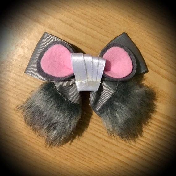 Remy Inspired Ratatouille Disney Pixar Mouse Hair Bow  Grey Grosgrain Ribbon with Grey Fur, Felt Mouse Ears and Satin Ribbon Mini Chef Hat Centrepiece.  Mounted on an alligator clip.  I can do custom bows, just let me know if youd like something specific.  Price is for single bow.