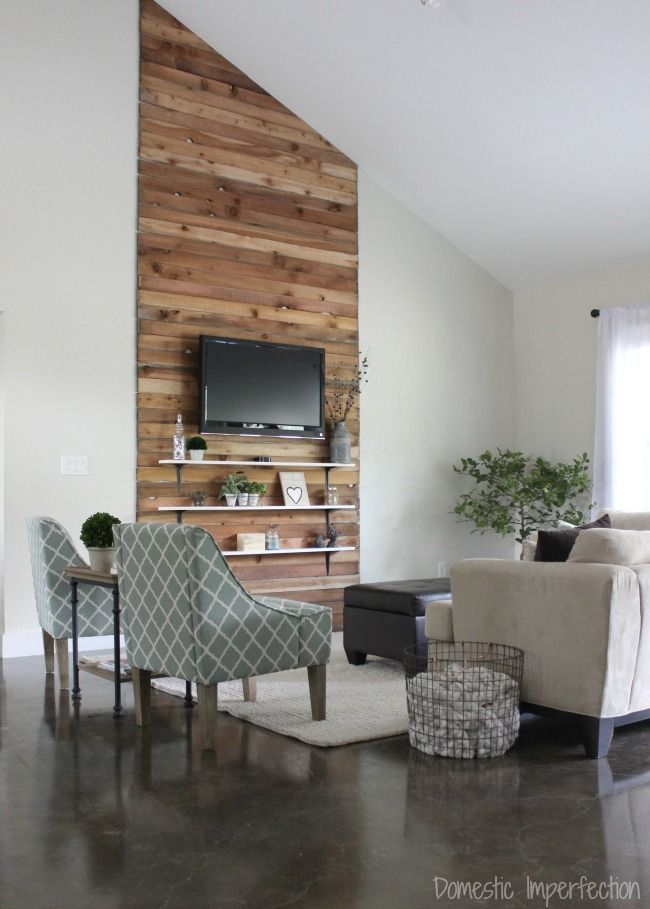 Farmhouse living room makeover on a budget. Love the rustic wood accent wall, which only cost $30!