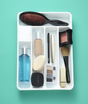 Snag a silverware holder from the kitchen to organize your daily beauty essentials in your bathroom drawer.