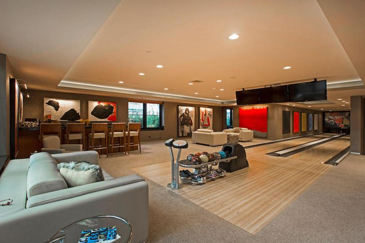Bowling alley in the basement pricey pads epic basements for Houses in houston with basements