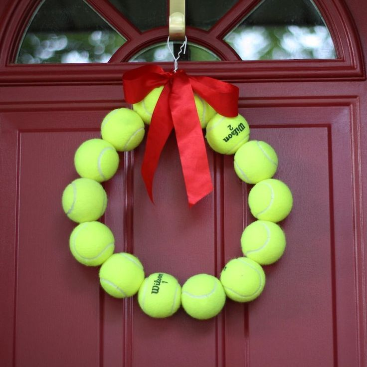 Tennis ball wreath diy ... would be really fun to hang during the Opens. :) The ribbon could coordinate with what Open is being played. lol.