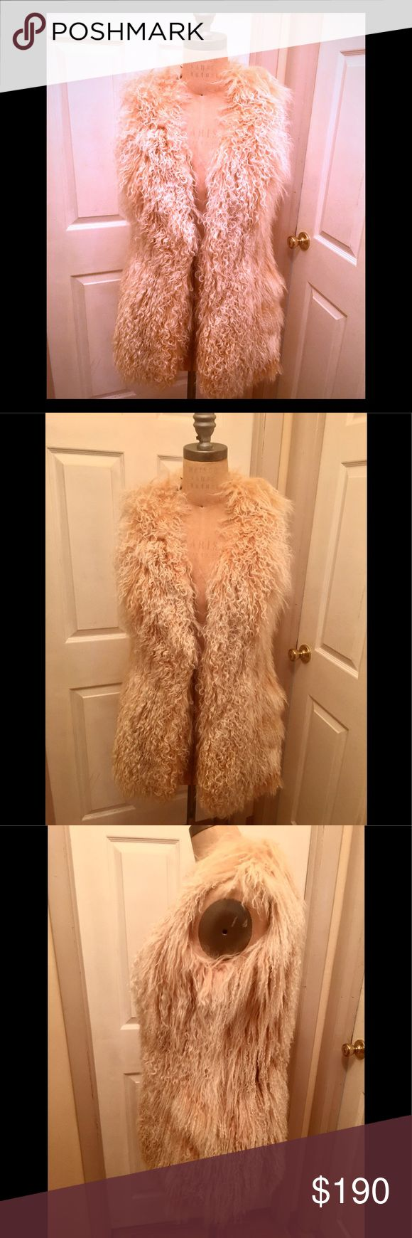 Like new LaRok Mangolian lamb fur vest w/suede Worn once. Like new, only selling because I just purchased the long Misha fur vest I have listed, they are very similar. Length 32inch long roomy. Lined w/silk & accented in brown suede, w/ hook & eye closure; 2 suede string accents hanging down w/ suede tassels for a 70s vibe. Great piece for spring. Wear w/jeans & crop top. I wore out w/see-through mesh turtle neck & leather skirt with booties out. Amazing piece! Great alternative if you want…