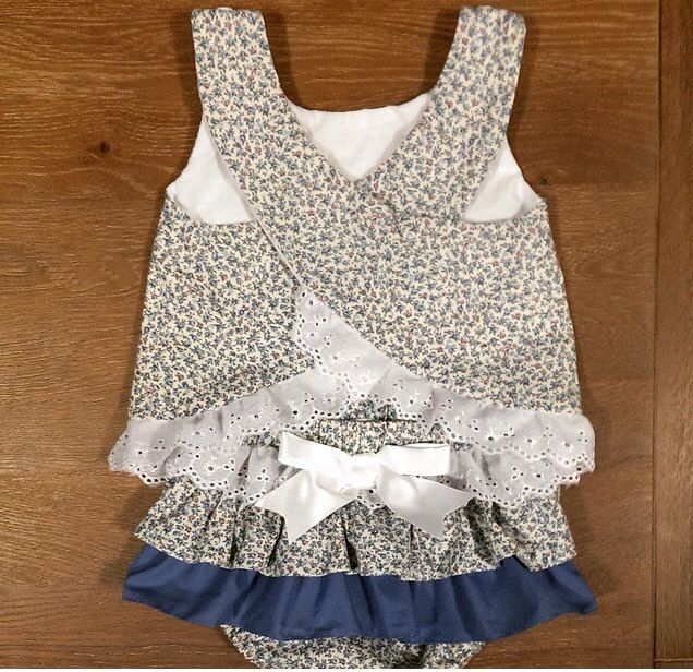 Zaylie_Co's gorgeous blue floral print made into a lovely summery criss cross top and nappy cover