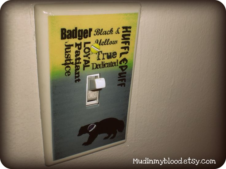 """Add some Wizard Flare to your muggle Bedroom or Hufflepuff Common Room!   Up-cycled Light Switch Plate which measures 2 3/4"""" by 4 1/2"""" The digital image is applied to plate and then sealed with a crystal clear glaze.   It has a picture of a badger and the characteristics attributed to the Huf..."""