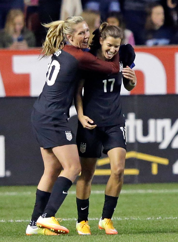 Allie Long and Tobin Heath after Heath's goal against Switzerland, Oct. 19, 2016. (Rick Bowmer/AP)