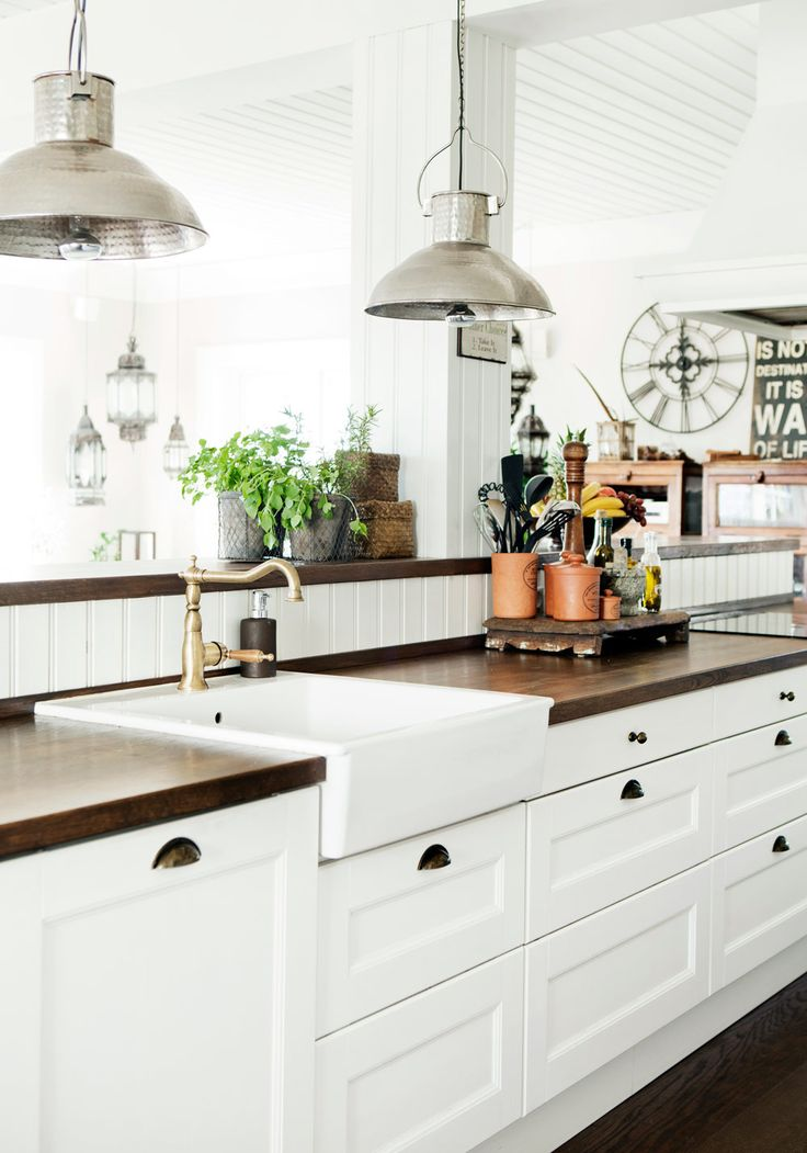 Kitchen....hammered metal pendants, gleaming wood counters, beadboard backsplash, farm sink, very farm/vintage.