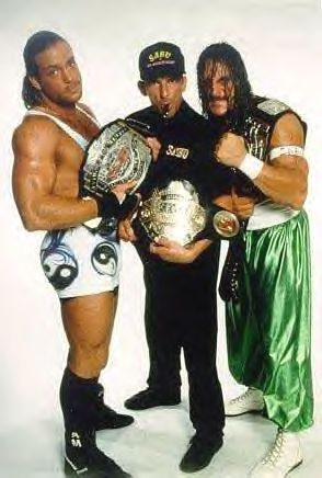 "ECW World Tag Team Champions ""The Whole F'n Show"" Rob Van Dam (also ECW Television Champion) and Sabu with Bill Alfonso"