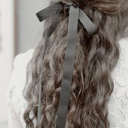 Octavia let Winn do her hair once. She carefully tied a complimenting black bow, making O feel like a little girl again. A wave of nostalgia slammed against her.