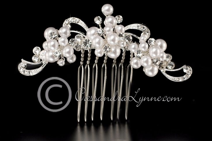 Lovely bridal hair comb designed with three clusters of white pearls and round rhinestones that are accented by silver swirls. It is 3.25 inches long and .75 inches high.