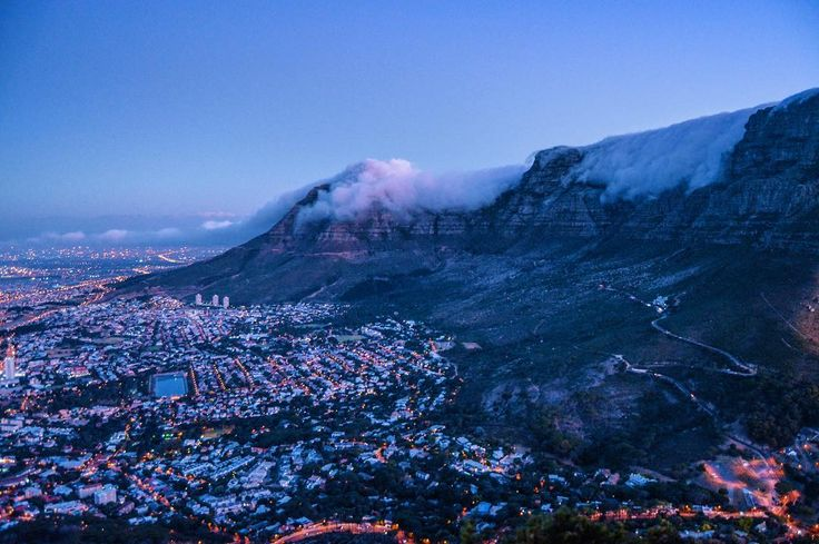 Cape Town CBD Table Mountain and Devil's Peak from Lion's Head. Amazing pic by @mattfos with my edits. #capetown #city #mountain #citylights #sunset #clouds #outdoors #hike #backpacking #backpackers #urban #southafrica #sundown #lights
