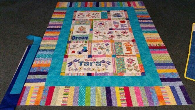 Hand applique quilt.  Flowers, laugh, love and dream.   Joy Ott designs
