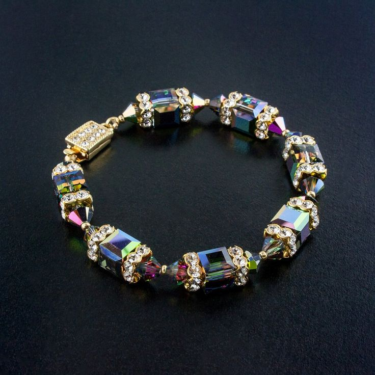 Glitterize you look with this vibrant, multicolor crystal bracelet. Each Swarovski crystal has hints of green, purple, red and blue - a beautiful accent for your next social occasion or night on the town.