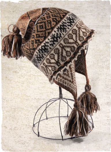 Our soft handloomed chullo is patterned in traditional Peruvian motifs in earthy shades of brown and cream, with pom-pom topper and tasseled...