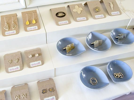LOVE the ceramic bowls and the bent card labels/tags. Simple and effective. Market display.