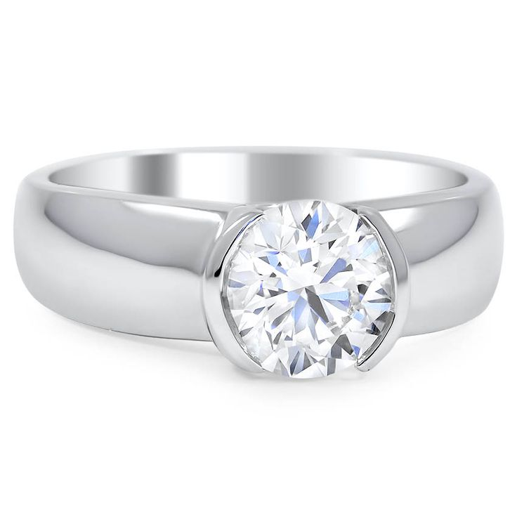 A scintillating round brilliant diamond in a semi-bezel setting is the centerpiece of this modern engagement ring. A wide 7mm band adds to the sleek quality of this piece.