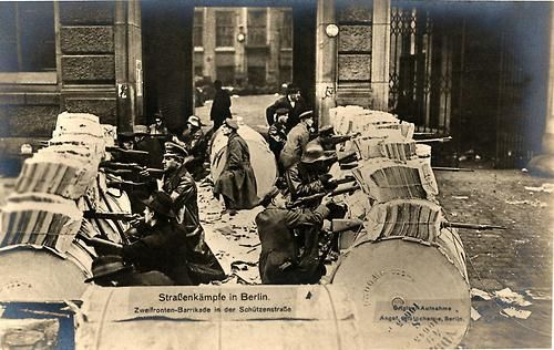 Spartacist fighters defending a barricade during the Spartacist Uprising in Berlin, 1919.