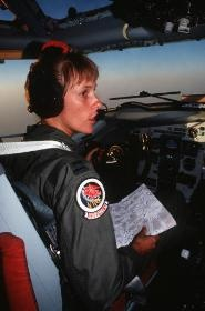 Capt. Katarina S. Bentler, the pilot of a 350th Aerial Refueling Squadron KC-135 Stratotanker aircraft, confers with her co-pilot while on a refueling mission during Operation Desert Shield.