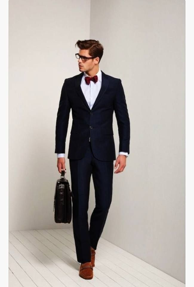 How to wear black and white suit more interesting? Try to put a red bow tie and brown shoes now!