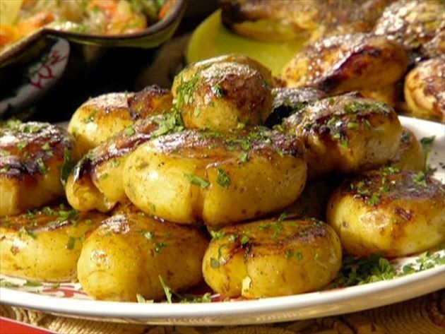 Get this all-star, easy-to-follow Yukon Gold Potatoes: Jacques Pepin Style recipe from Rachael Ray