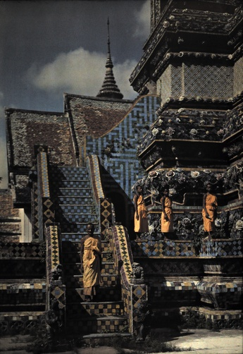 Autochrome: W. Robert Moore. A Buddhist priest and his novices stand at the base of a temple.