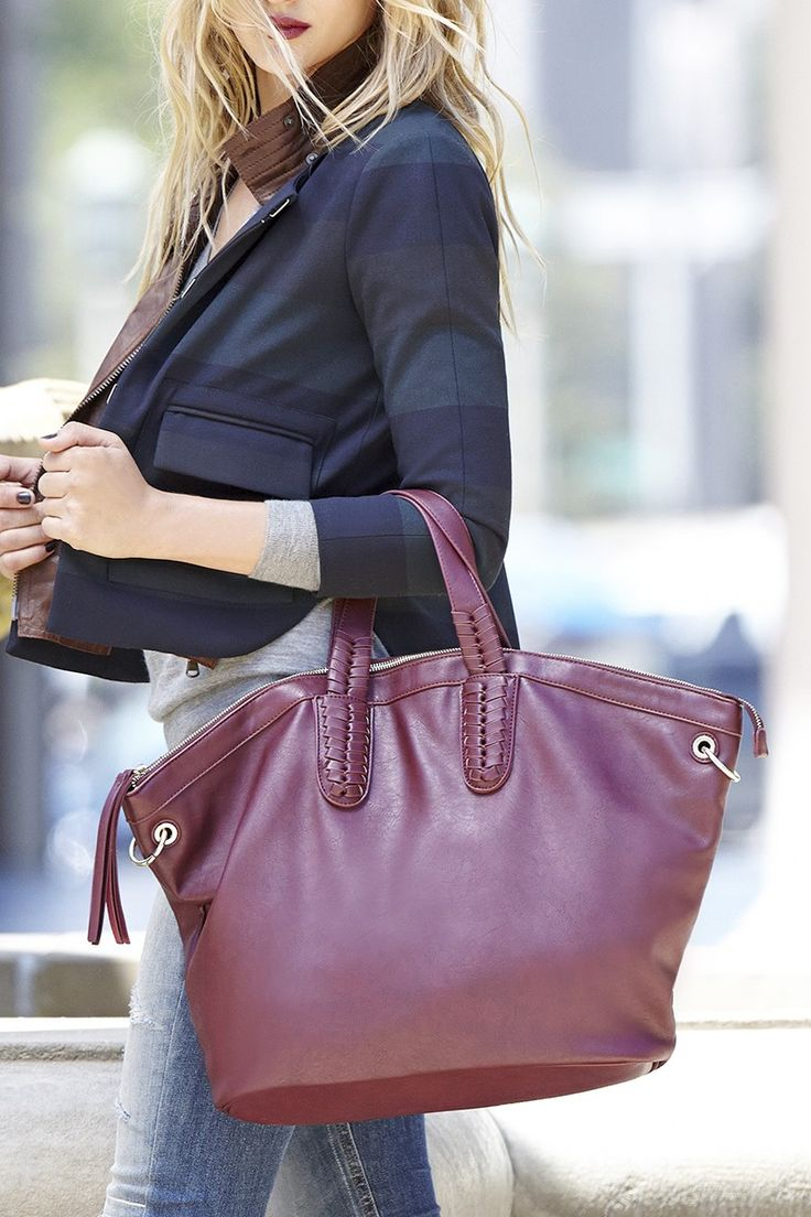 Spacious tote bag with braided handles in a rich berry hue