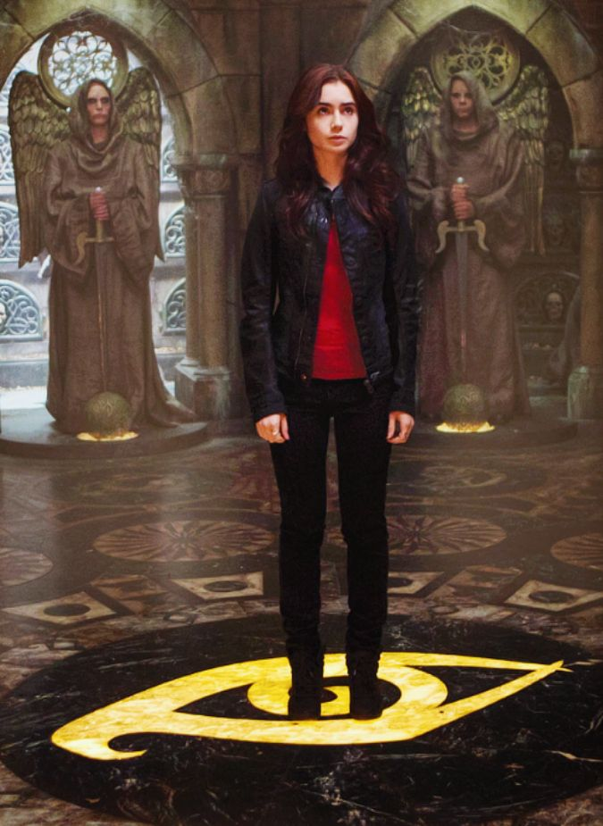 WHOA! New still of Clary in the City of Bones standing atop of a huge Clairvoyant Sight rune